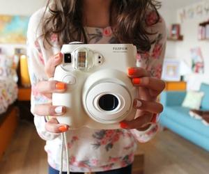 camera, nails, and polaroid image