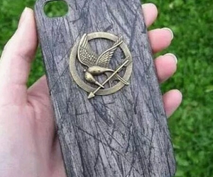 phone, the hunger games, and sinsajo image