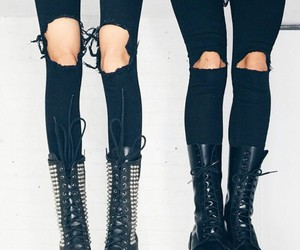 combat boots, ripped denim, and studded combat boots image