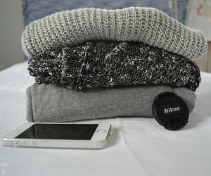 iphone and sweater image