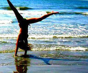 bathing suit, beach, and handstand image