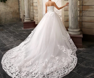 flowery, long tail, and wedding dress image