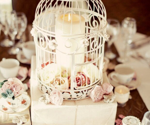 cage, candle, and roses image