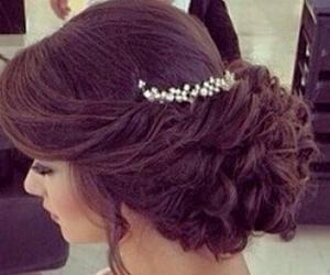 bun, curls, and elegant image