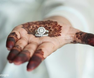 henna, wedding rings, and indian bride image