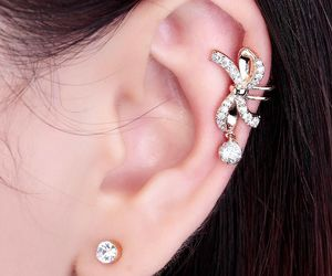 bow ear cuff, gold bow ear cuff, and silver bow ear cuff image