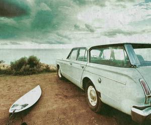 car, beach, and surf image