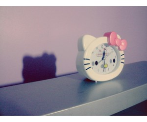 clock, hello kitty, and kitty image