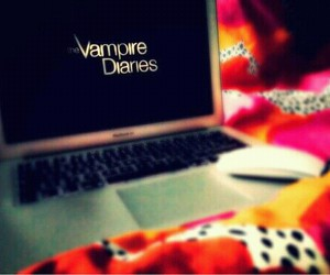 blankets, laptop, and tvd image