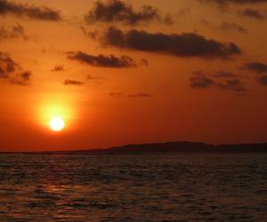 sun, clouds, and sea image