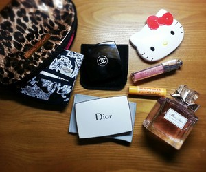 burt's bees, chanel, and dior image