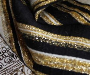 black, gold, and woven fabric image