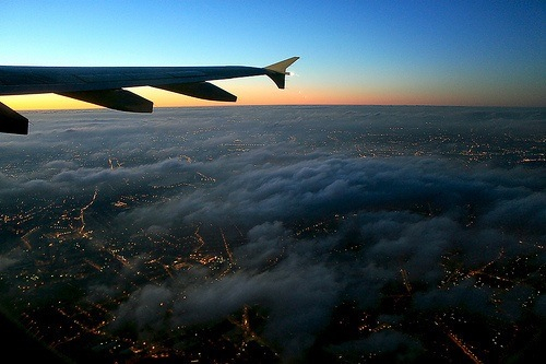 sky, plane, and city image
