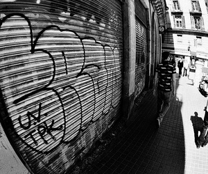 black and white, shutters, and graffiti image