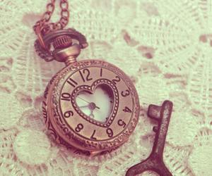 key, clock, and heart image