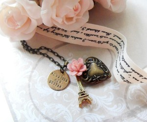 eiffel tower, flower, and necklace image