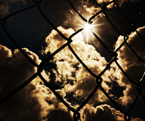 clouds, fence, and sun image