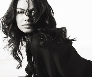Mila Kunis and girl image