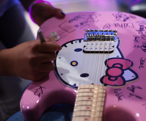 hello kitty and guitar image