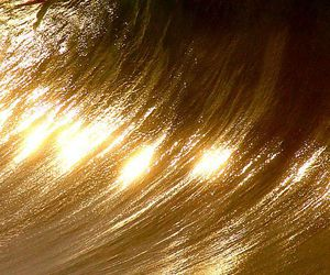 sea, gold, and waves image