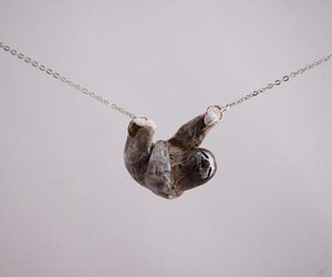 sloth and necklace image