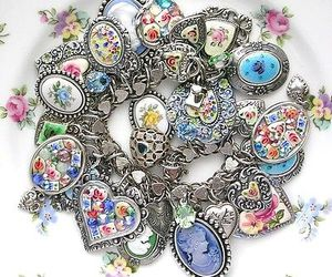 flowers, hearts, and charm bracelet image
