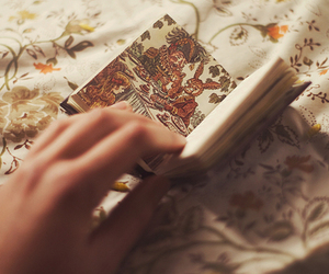 book, picture, and hand image