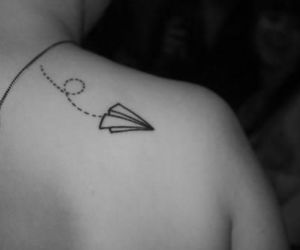 ink, paper plane, and tatoo image