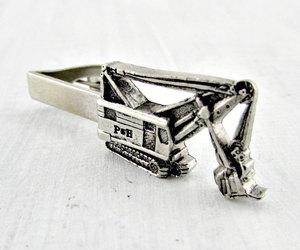 heavy equipment, silver tie clip, and vintage tie clip bar image
