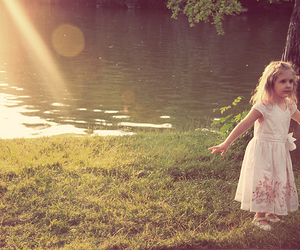 girl, sun, and river image