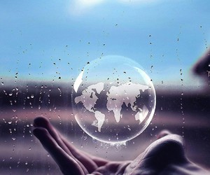 world, hand, and bubble image