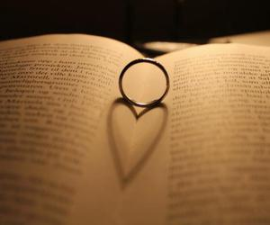 book, light, and heart image