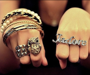 rings, bracelet, and owl image
