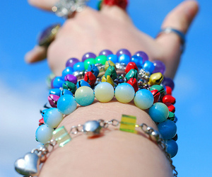 arm, beads, and circus image