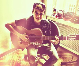 guitar, singer, and one love image
