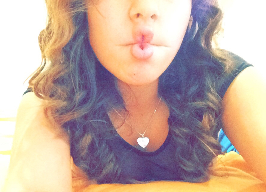 curly hair, heart shaped necklace, and pink lip balm image