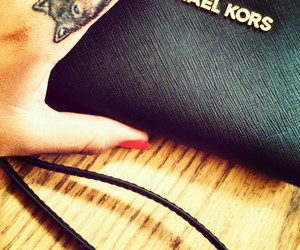 Michael Kors, Tattoos, and wolves image
