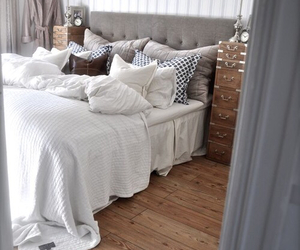 bed, bedroom, and pillows image