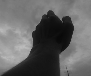 black and white, cloudy day, and hands image