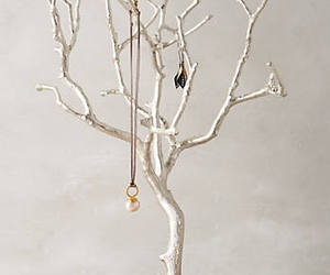 jewerly, prop, and tree image