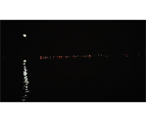 city lights, moonlight, and ocean image