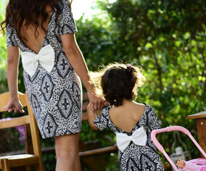 daughter, mother, and dress image