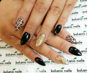 black, leopard, and acrylic nails image