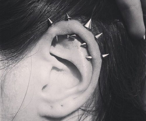 black n white, metal, and piercing image