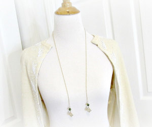 gold chain necklace, gold clover necklace, and good luck jewelry image