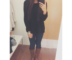 black sweater, boots, and brown boots image