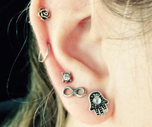 piercing and hamsa image