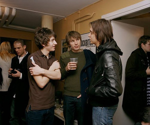 alex turner, the strokes, and arctic monkeys image