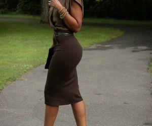 black clutch, brown top, and black heels image