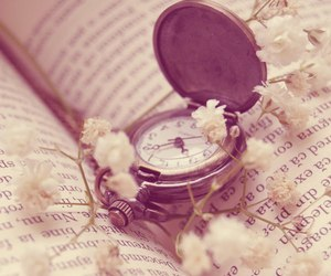 clock, book, and flowers image